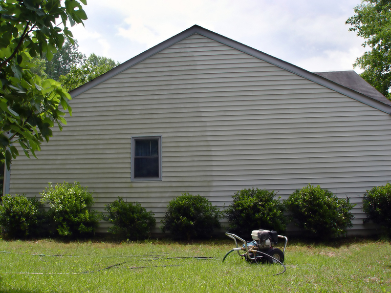 image of half washed house siding